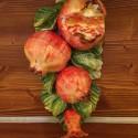Granatäpfel und Blumen Ranke