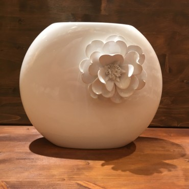 Canoe vase with flower
