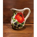 Pitcher with tomato and olive decoration